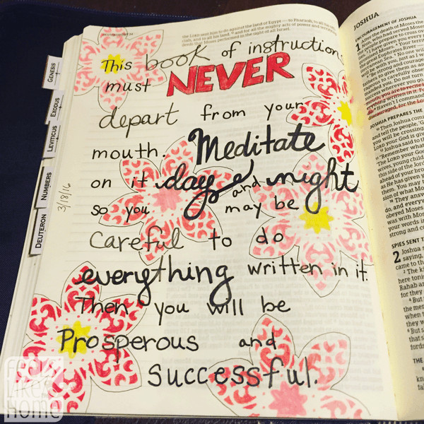 A close up of Bible journaling on a white background
