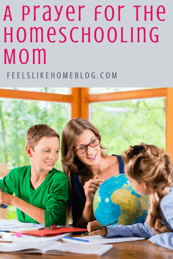 A homeschool mom showing her kids places on a globe