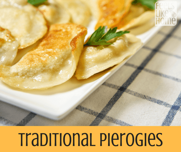 A close up of a plate of food, with Pierogi and Butter and onions