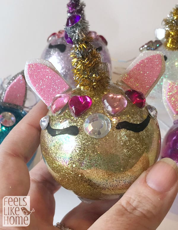 A gold unicorn Christmas ornament