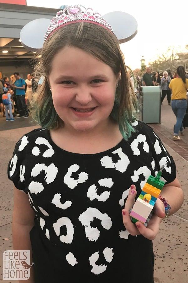 Grace Ziegmont holding a Lego creation