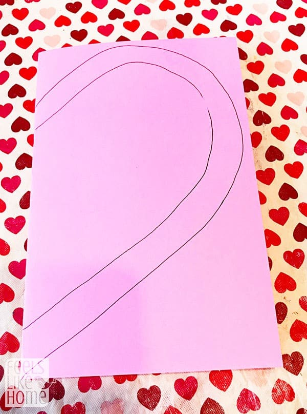 Fold the paper and trace a heart