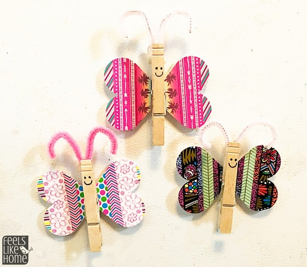 3 washi tape butterfly magnets on the fridge