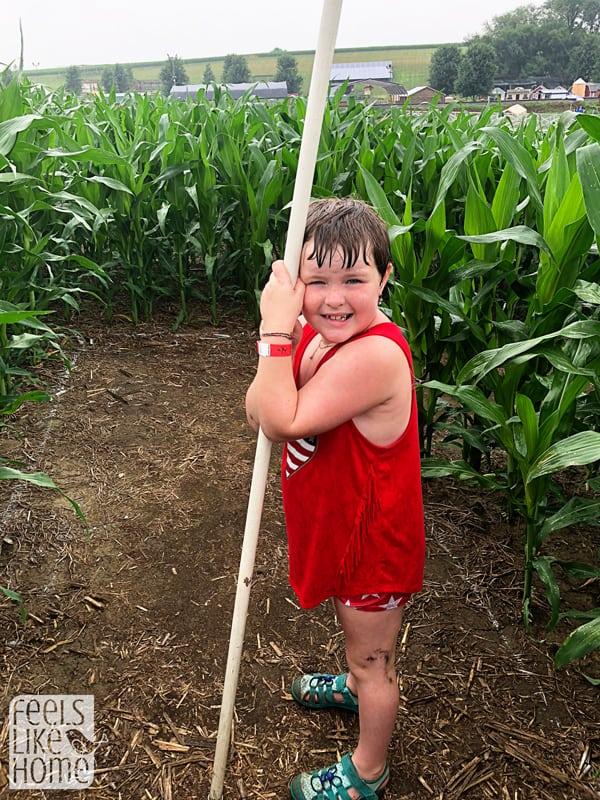 A little girl standing in a field of corn