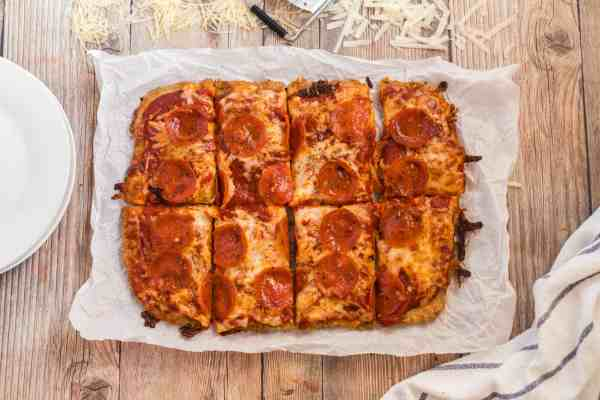 A chicken crust pizza cut into slices