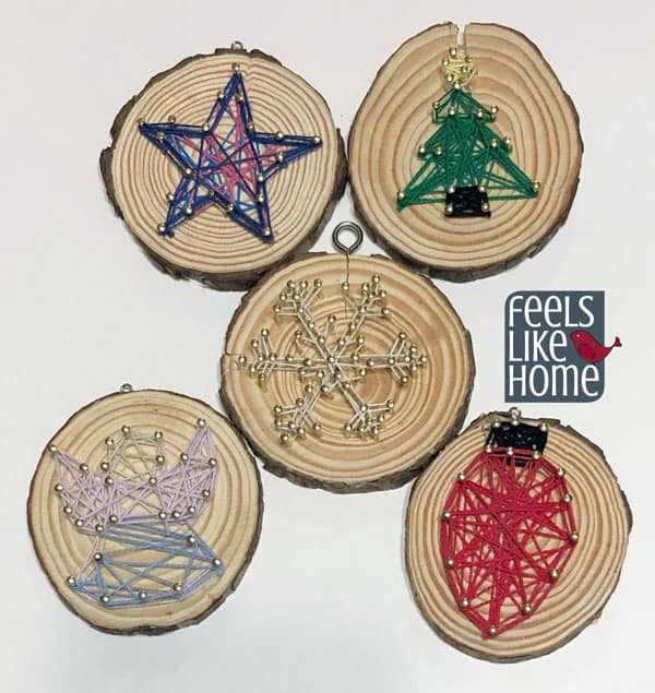 A close up of all the Christmas string art ornaments