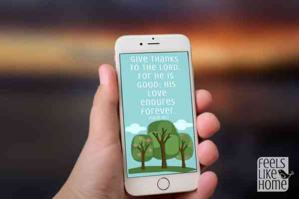 A cellphone with a Bible verse wallpaper