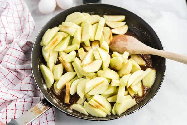 add apples to the brown sugar in the skillet