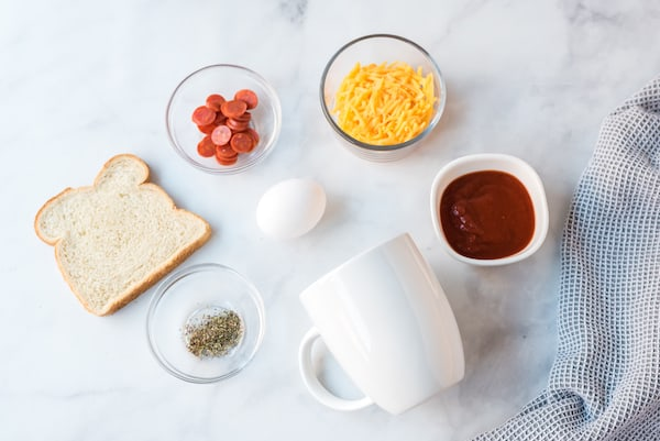 a mug and pizza ingredients