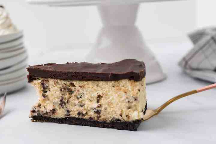 one slice of chocolate mint cheesecake on a serving spatula