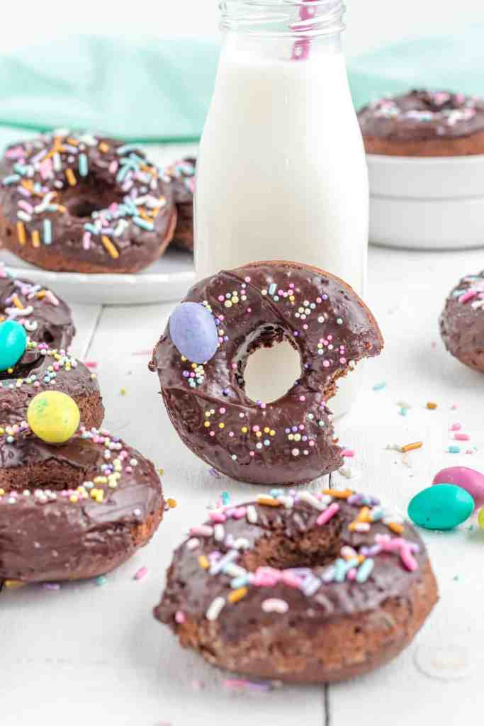 a chocolate frosted chocolate donut with milk