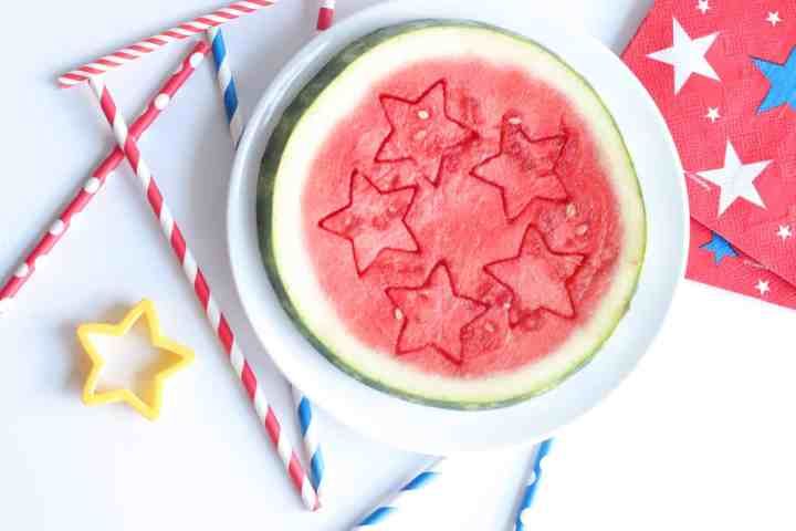 a slice of watermelon cut into star shapes