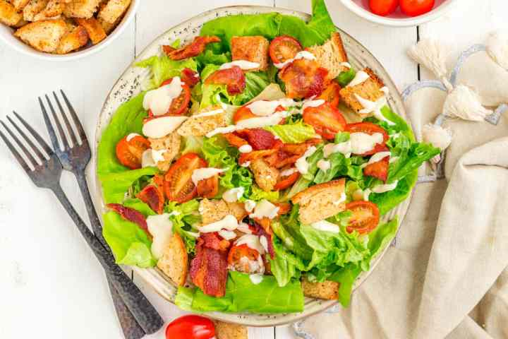 BLT salad with homemade dressing drizzled over top