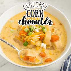 crockpot corn chowder with carrots and cheese in a white bowl