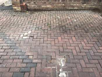 concrete on driveway before pressure cleaning