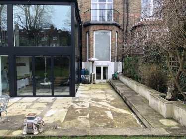 Dirty Portland stone patio Cobham Surrey