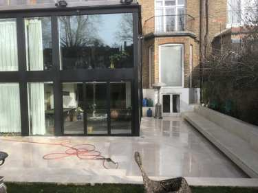 Portland stone patio cleaned by Feel the pressure UK