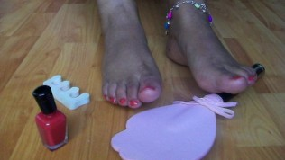 Black Women Putting Paint On Her Feet And Teasing