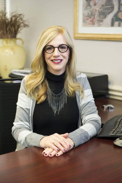 Pam Feinberg-Rivkin at desk