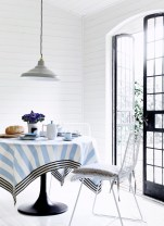 Ian Mankin Tablecloth in Devon Stripe Bluebell & Ticking 02 Black, £24.50 per metre, napkins in Norfolk Stripe Bluebell & Ticking 01 Black £24.50 per metre