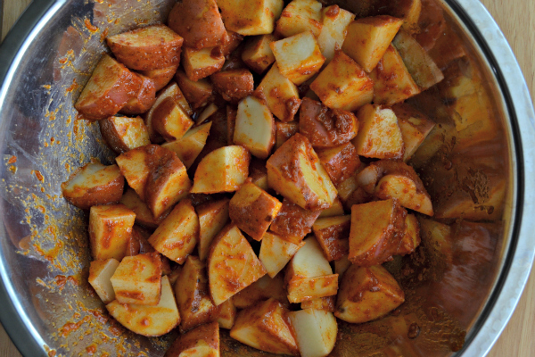 Step 2: Coat the diced potatoes in the sauce mixture