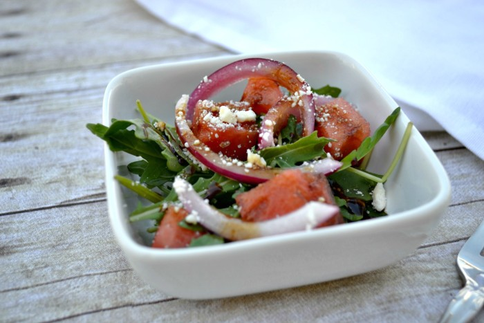 watermelon salad with arugula, feta, pickled onions and balsamic reduction
