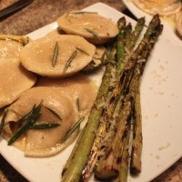 Pumpkin Ravioli With Rosemary Butter Sauce & Grilled Asparagus with Lemon Zest