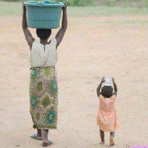 Mother and daughter fetching water
