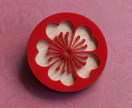 Red blossom brooch