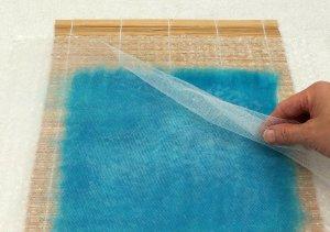 carefully peel away the net