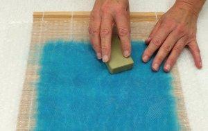 draw bar of soap across fibres through the net