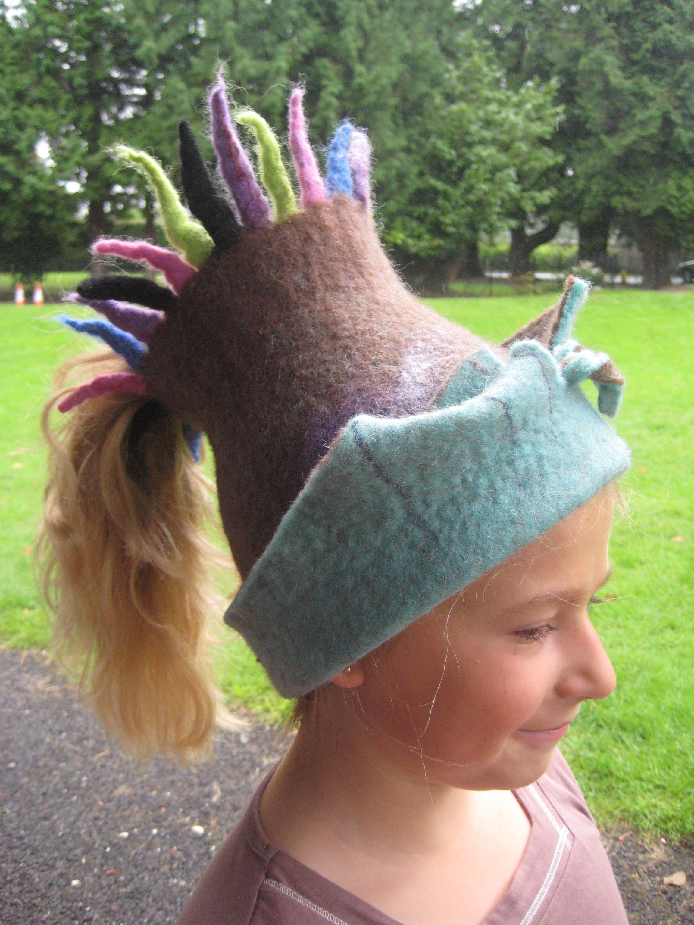Anna wearing a hat designed by Maureen Cromer