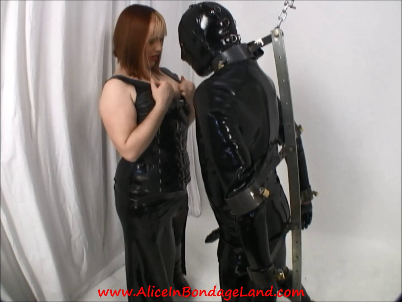 Rubber slave bondage latex dom