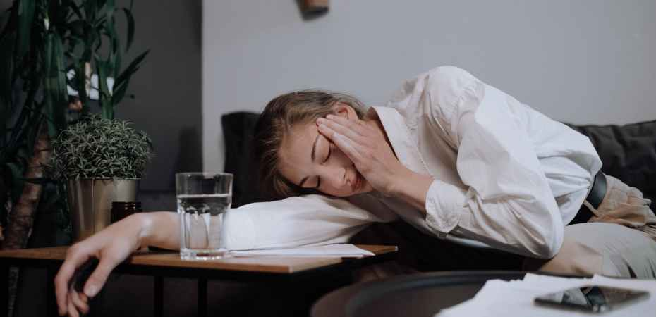 exhausted woman falling asleep on table