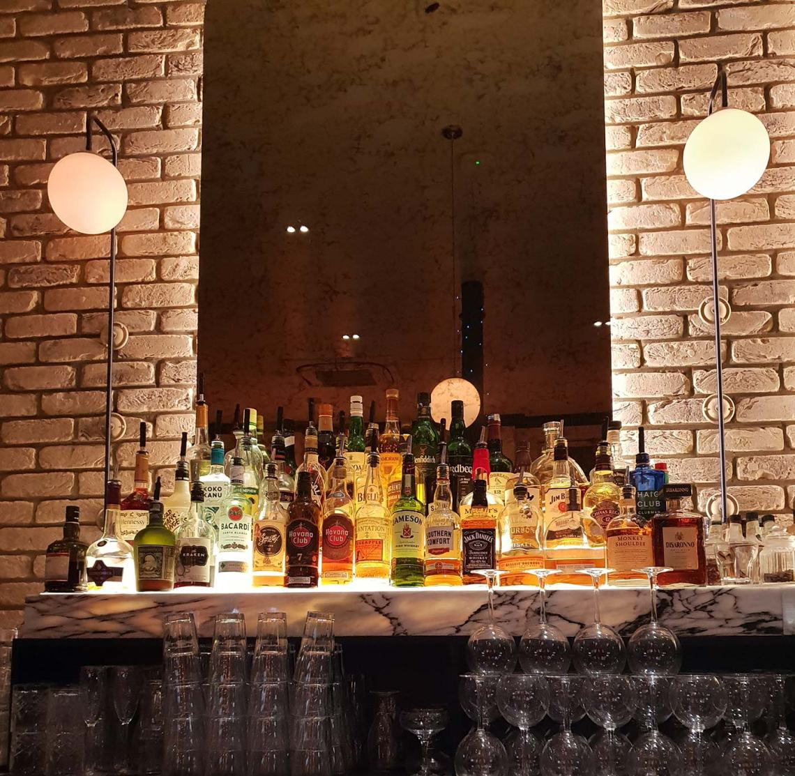 A well stocked bar with a mirrored background. Castle Street Townhouse, Liverpool - Female Original