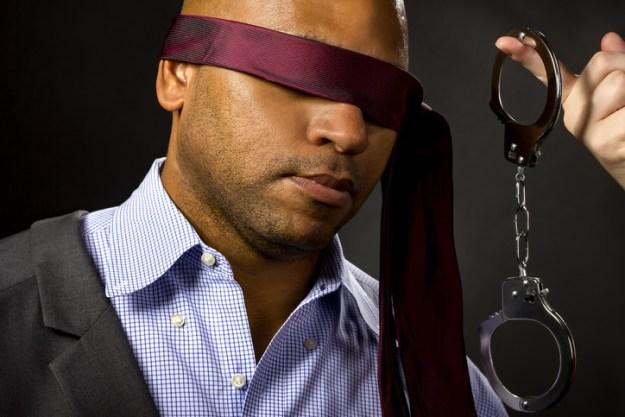 slave wearing blindfold