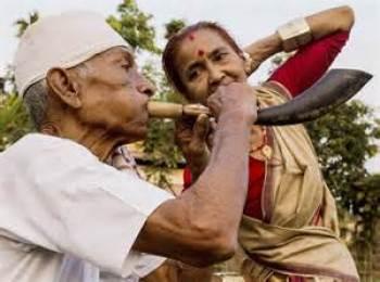 elderly couple celebrating Bihu