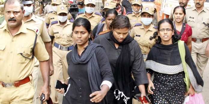 Members of the Manithi team returning midway after protesters disrupted their trek to Sabarimala. Image courtesy: The New Indian Express