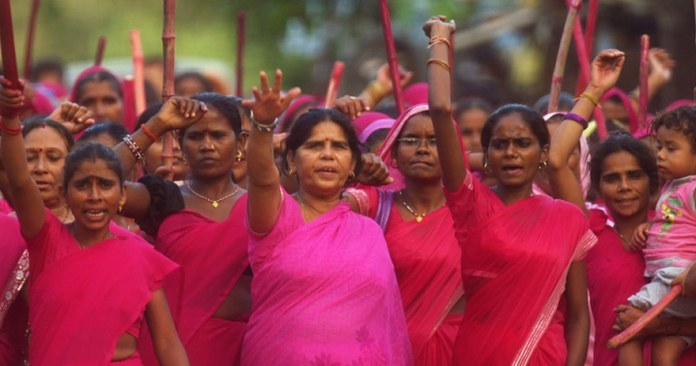 The women of Gulabi Gang wearing pink and raising slogans at a protest.