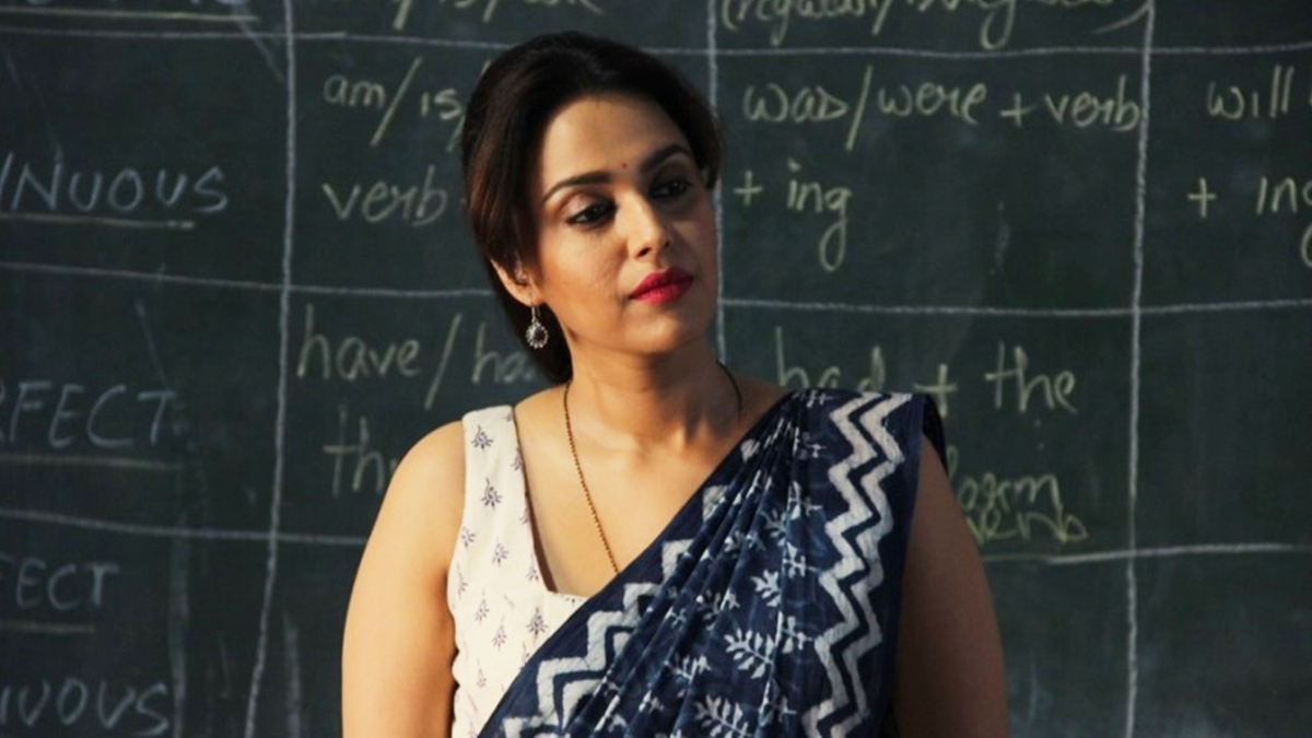 "Rasbhari is based in Meerut, with overt references throughout the show reminding us of its conservative people. Shanoo (Swara Bhaskar), an English school teacher is sexualised by her students Nand and his friends (all of 16-17 years of age, considering they are shown as in the eleventh standard), who lust after her and want Nand to ""open his account"" meaning losing his virginity to her."