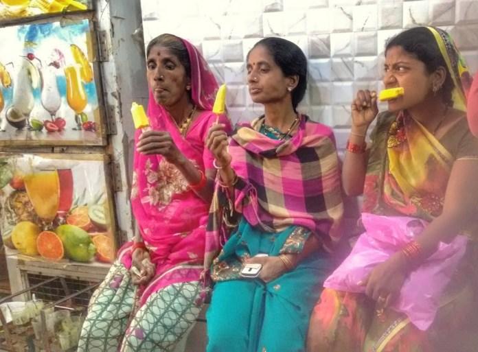 Women at Leisure: Women enjoying an ice cream break on a hot summer afternoon
