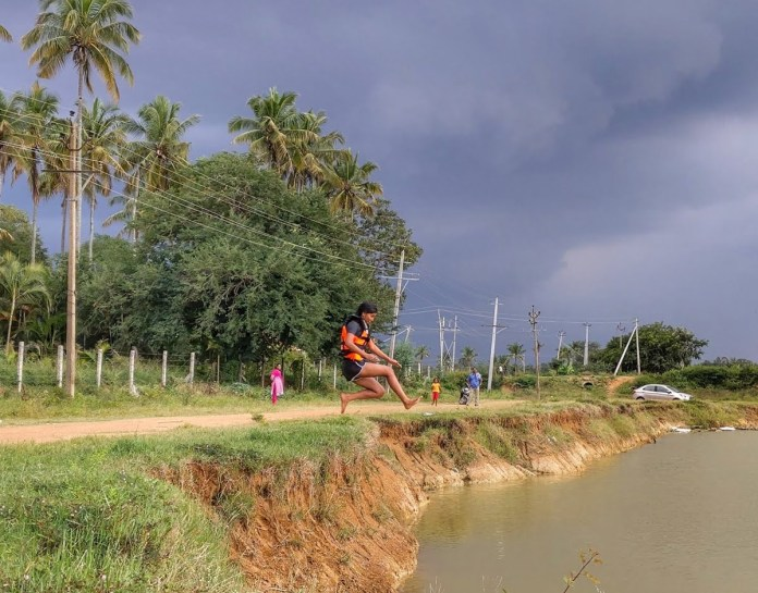 Women at Leisure: Deepa jumping into a pond which got some water due to unexpected rain.