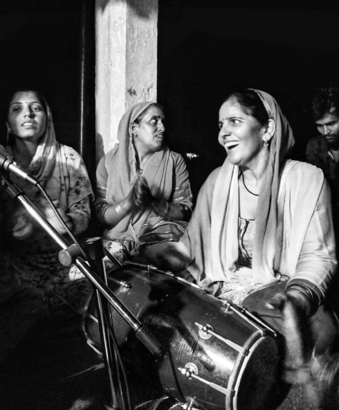 Women at Leisure: A group of women in the village got together in the nearest temple at 9PM to celebrate Janmastami, a Hindu festival. They celebrated Lord Krishna's birthday by singing and dancing together until midnight.