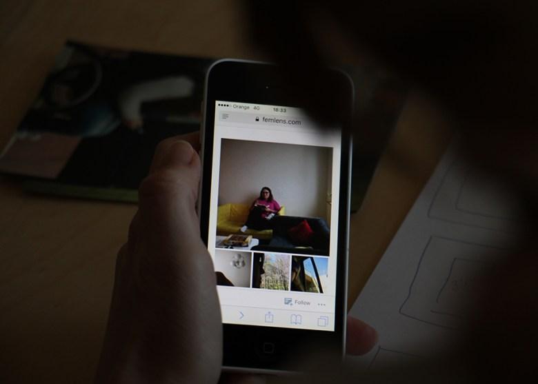 femlens.com photos on phone screen