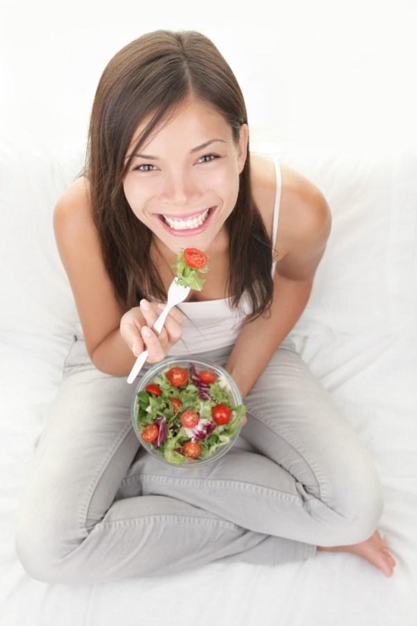 Sitting eating a salad