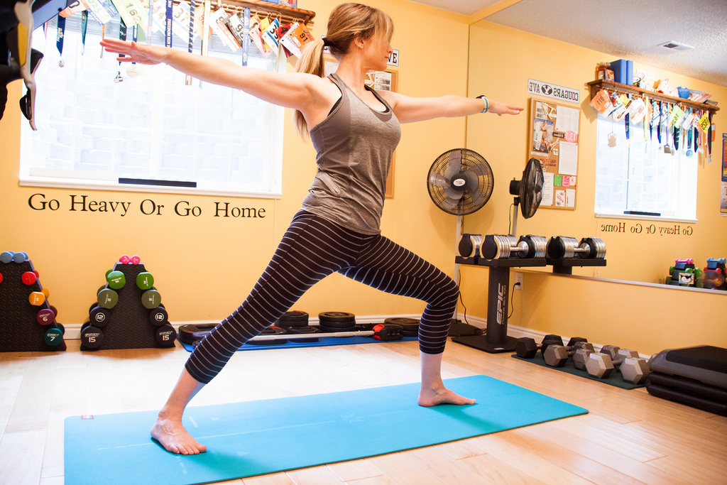 woman doing yoga How to create your own amazing home gym #homegym #gymequipment #weightrack #treadmill #yogamat #health #fitnesstip #homegymtips #gym