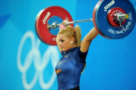 Lidia Valentin of Spain competes in the women's 75 kg weightlifting event during the 2008 Beijing Olympic Games on August 15, 2008. AFP PHOTO/JUNG YEON-JE (Photo credit should read JUNG YEON-JE/AFP/Getty Images)