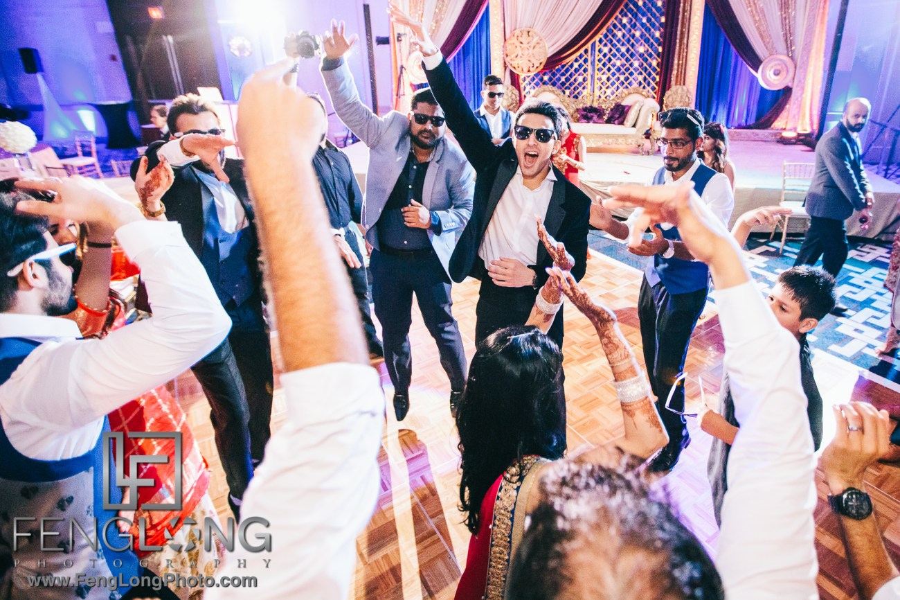 Indian wedding reception bride and groom dance photo