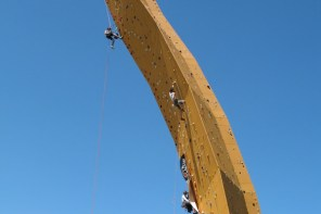 the excalibur climbing wall in groningen. yellow and slightly curved, 37 metres high