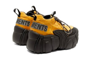 vetements x SWEAR platform shoe. yellow top, black platform heel. perfect for raves or hiking with tall people.
